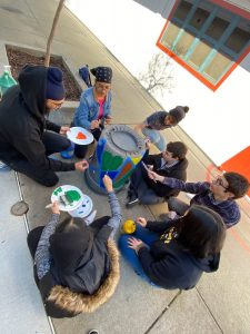 Senior Paints Trash Cans to Promote Recycling